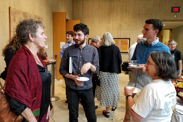 Students and faculty talking at a reception